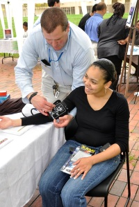 Photo of a young woman getting her blood pressure taken